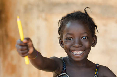 Education for Africa Symbol: Beautiful Young Schoolgirl Toothy Smile Archivio Fotografico
