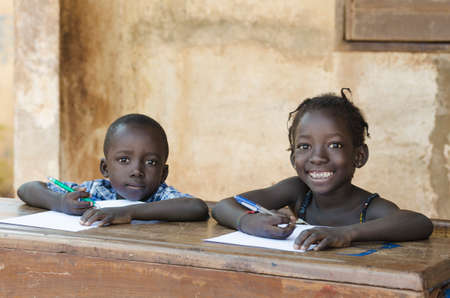 Cute Little Children Learning with Pens and Paper in Africa (Schooling Education Symbol)