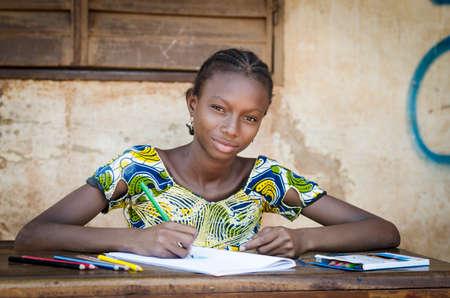 African School Girl Posing for an Educational Shot Symbol 写真素材