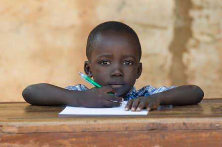Very Proud Black African Boy Posing Under The Sun Writing 写真素材