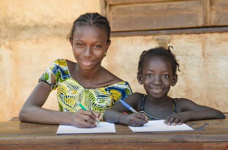 School For African Children - Couple Smiling Whilst Learning