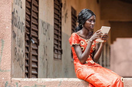 Reading Symbol: African Black Ethnicity Woman Reading On Tablet Computer