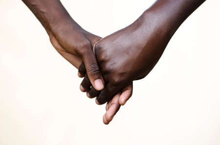black hands: Friendship Symbol: Black People Holding Hands Together. Symbol for fight against racism, peace for the world!