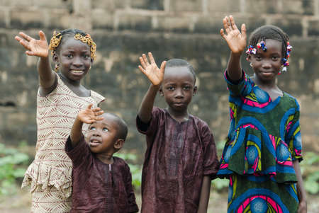 Little african children waving hands on blurred background