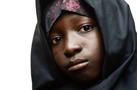 Front view of African girl veiled with black burqa Archivio Fotografico