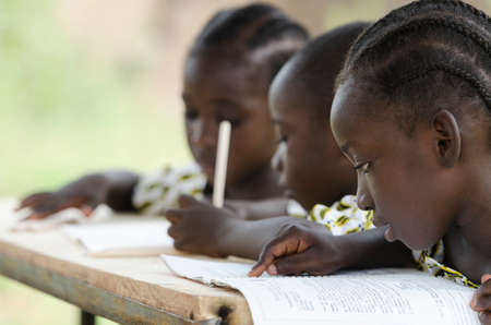 Little african children studying at school with blurred background Zdjęcie Seryjne
