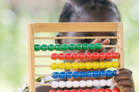 African girl counting on abacus education symbol