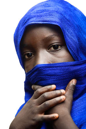 lybia: African woman child with a blue scarf around her face niqab Stock Photo