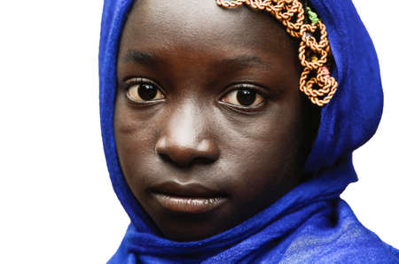 lybia: Sad little African girl looking at camera typical blue scarf Stock Photo