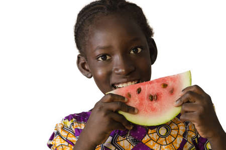 Gorgeous African black child eating some watermelon, isolated on white