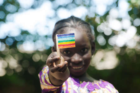 Young black African girl showing peace flag with her hands