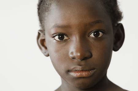 Sad African child showing her face for a portrait, sadness despair symbol, isolated on white