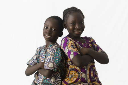 Couple of African brother and sister posing in studio, isolated on white Zdjęcie Seryjne