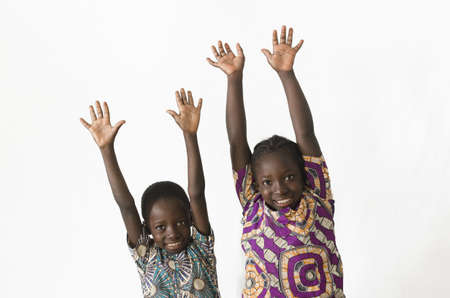 Two beautiful African children playing with their hands, isolated on white