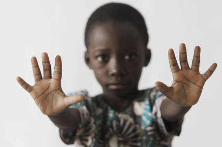 African boy STOP sign with his hands, isolated on white Zdjęcie Seryjne