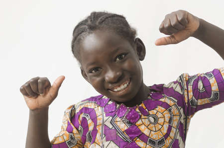 Little African child showing thumbs-up, happy girl, isolated on white Zdjęcie Seryjne