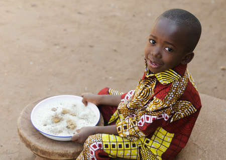 Eating in Africa - Little Black Boy Hunger Symbol