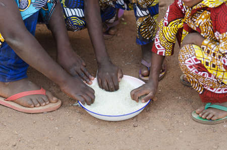 Close-Up Shot of Young African Boys and Girls Eating Outdoors