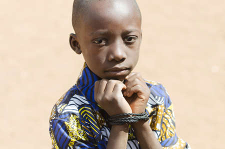 African Black Boy Slavery Refugee Symbol with Copy Space