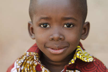 Happy Little African Boy Smiling At Camera Portrait Zdjęcie Seryjne