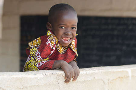 Adorable Little Black African Ethnicity Boy Smiling Outdoors Copy Space