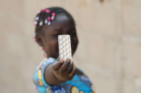 Young African Girl with Charity Medicine Drugs