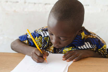 Black African Boy at School taking notes during class Zdjęcie Seryjne