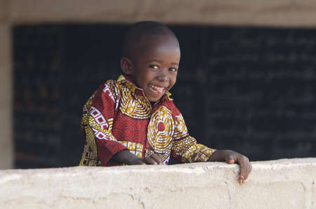 Gorgeous African Child Smiles at School Banner Background