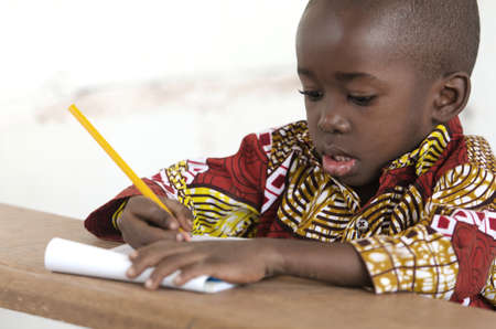 Adorable Little African Child Writing at School in Bamako, Mali