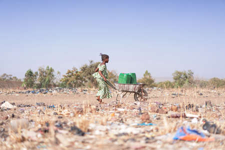 Beautiful African Women Bringing Clean Water for an insufficiency concept