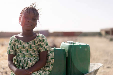 Real African Girl with nutritiousWater for a lack of water symbol Imagens