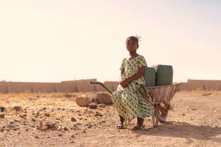 Beautiful Native African Young Girl with Pure Water in a rural village