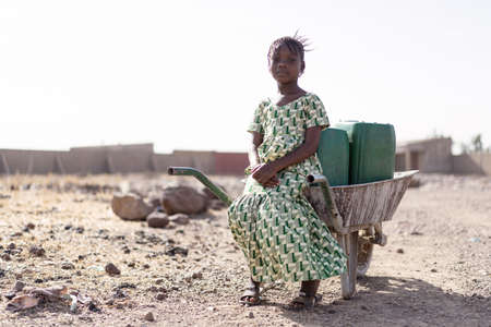 Young African Woman Gathering Fresh Water in a rural village