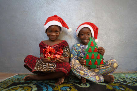 Two Gorgeous African Black Children Present and Christmas Tree