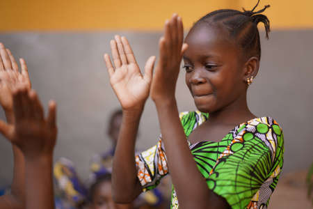 Young African Girl Concentrating On Her Hand Clapping Game Reklamní fotografie