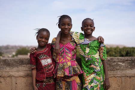Three Pleasant African Girls Posing For A Panorama Picture On a Bridge