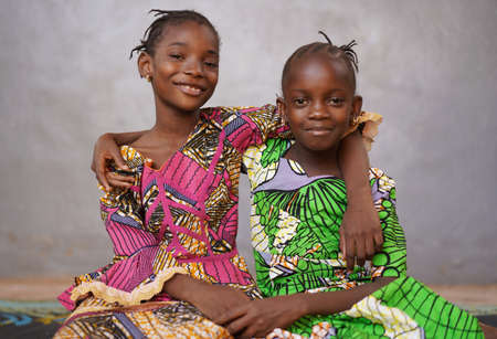 Beautiful Picture of Two African black girls Smiling and Laughing
