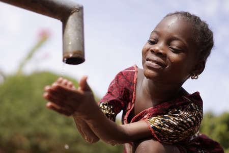 Close Up of African Black Ethnicity Girl Beautiful Drinking Water for Health Stock Photo