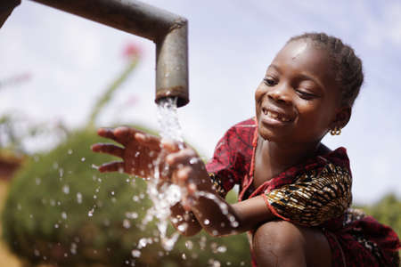 Water is Life for African Children, Little Gorgeous Black Girl Drinking from Tap Archivio Fotografico