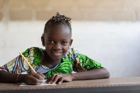Portrait of Cute African Girl at School doing Homework