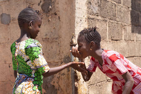 Sharing Water, Gorgeous Girls Drinking Water Together - Human Rights Symbol