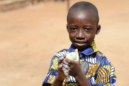 Handsome Little Black Boy Cleaning Hands Posing as a Health Concept Against Virus, Bacteria, Disease and Illness