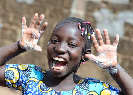 Gorgeous African Black Young Girl Happy About Washing her Hands with Sanitizer, Soap and Water