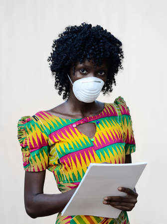 Gorgeous African Black Woman Posing with Face Mask to Protect from Infection, Bacteria, Virus Reklamní fotografie