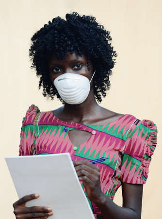 Beautiful African Doctor Noting Patient Illness Wearing Face Mask Medical Equipment to avoid contamination Reklamní fotografie