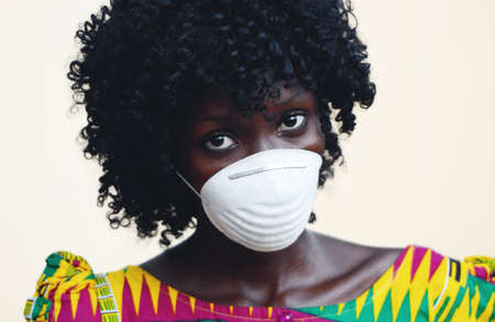 African Woman Close Up Posing with Facial Mask to Protect from Infections from Bacteria, Viruses and Epidemics Reklamní fotografie