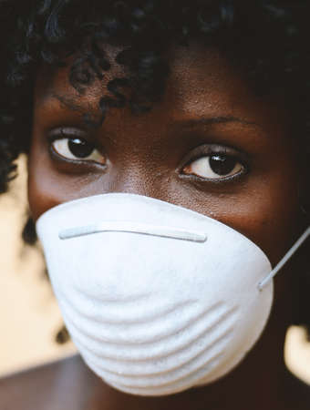 Beautiful African Woman Student Posing with Virus Mask To Protect Herself