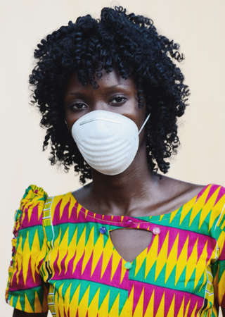 Face Masks for African People confronting global epidemic, gorgeous African Woman Wearing Face Protection