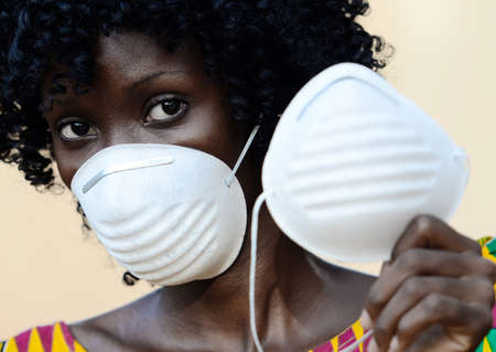 Young African Black Woman Wearing Medical Prevention Face Mask Wearing Traditional Clothing