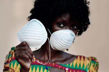 Young and Gorgeous African Woman Nurse Doctor Wearing a Face Mask Prevention from Virus Outbreak
